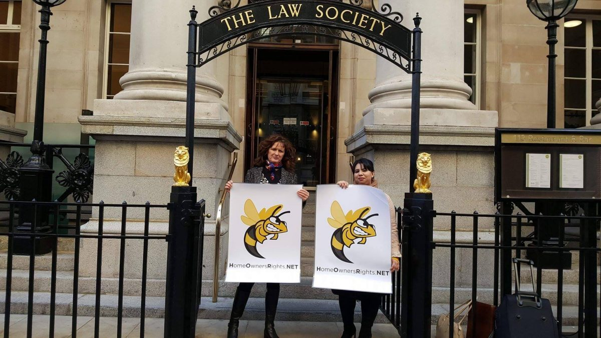 HorNet members posing with placards in front of the Law Society